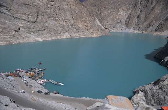 In this photograph taken on on August 3, 2015, Pakistani residents board boats used to cross Attabad Lake, which was formed following a landslide in January 2010, in Pakistan's Gojal Valley. Karachi, 2050: The sprawling megacity lies crumbling, desiccated by another deadly heat-wave, its millions of inhabitants suffering life-threatening water shortages and unable to buy bread that has become too expensive to eat. It sounds like the stuff of dystopian fiction but it could be the reality Pakistan is facing. With its northern glaciers melting and its population surging -- the country's climate change time bomb is already ticking. AFP PHOTO / Aamir QURESHI