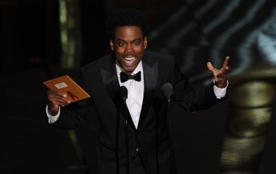 Actor Chris Rock performs at the 84th Annual Academy Awards on February 26, 2012 in Hollywood, California.