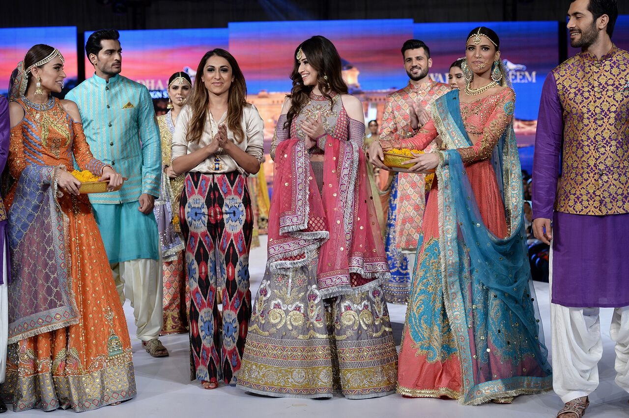 5e28d68f96 The men collection consisted of bright Sherwani colours, patterned kurtas in  colours of orange and pink. Wardah Saleem's collection replicated the ...