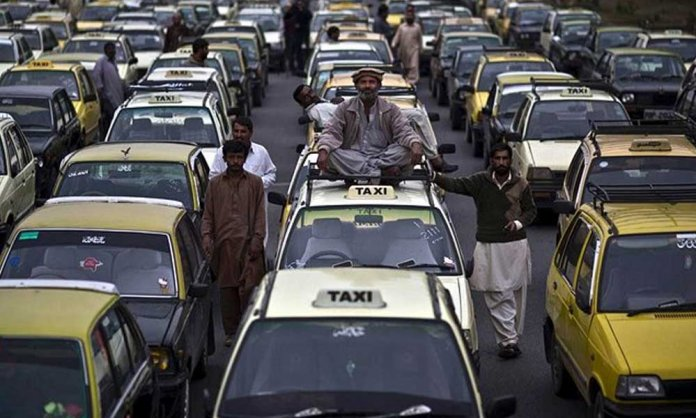 rickshaws and taxis banned on tariq road