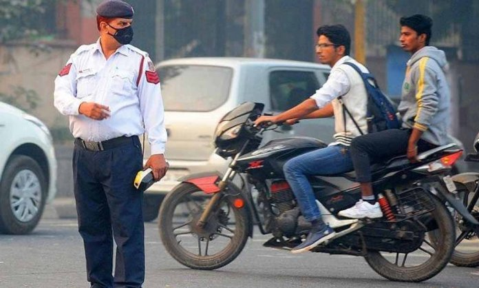 police fining bikers without helmets
