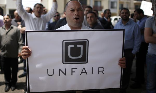 Uber laysoff employees