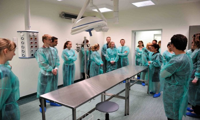 Medical students being prepared for test operations