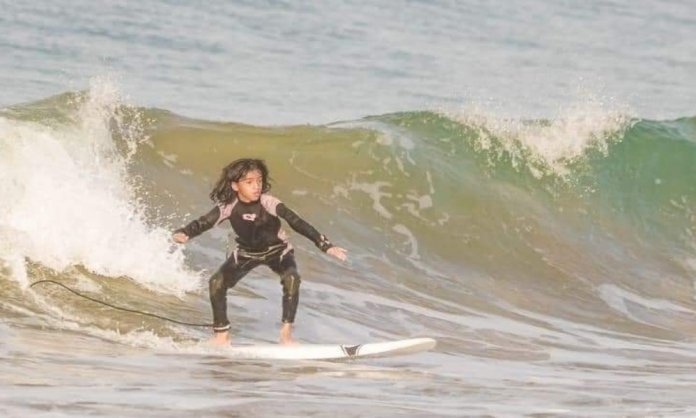 The 9 year old surfing