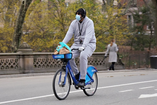 A man cycling in NYC during lockdown