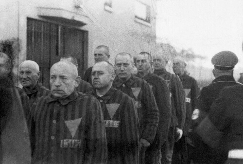 The prisoners at concentration camps with the symbol on their uniform.