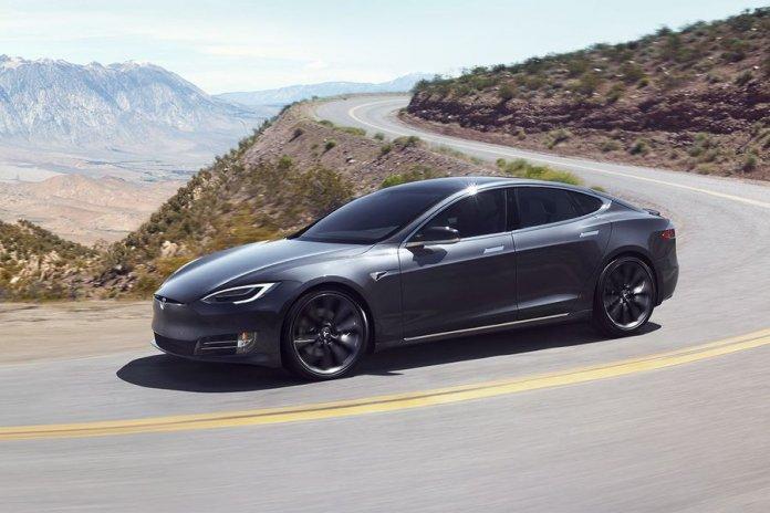 Tesla vehicle driving sentry