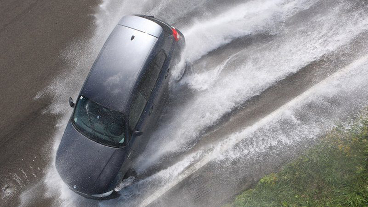 hydroplaning car in bad weather and controlling