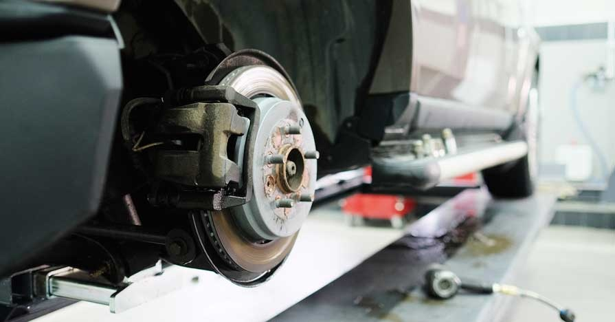 checking car brakes in rain and other equipment
