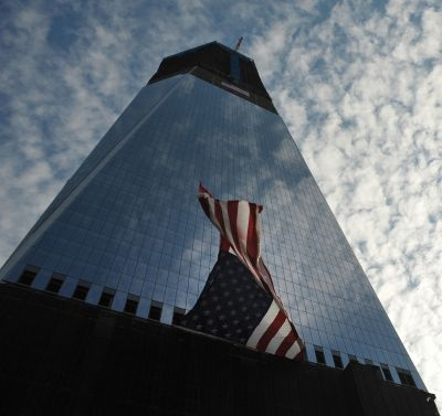 A US flag billows on Freedom Tower in New York City