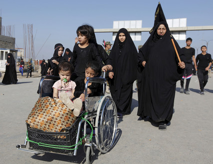 Shi'ite Muslim pilgrims travel to the holy city of Kerbala, ahead of the holy Shi'ite ritual of Arbaeen, in Baghdad