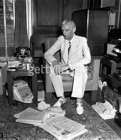 Jinnah in his study