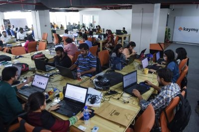 Pakistani employees of online marketplace company Kaymu at work in Karachi