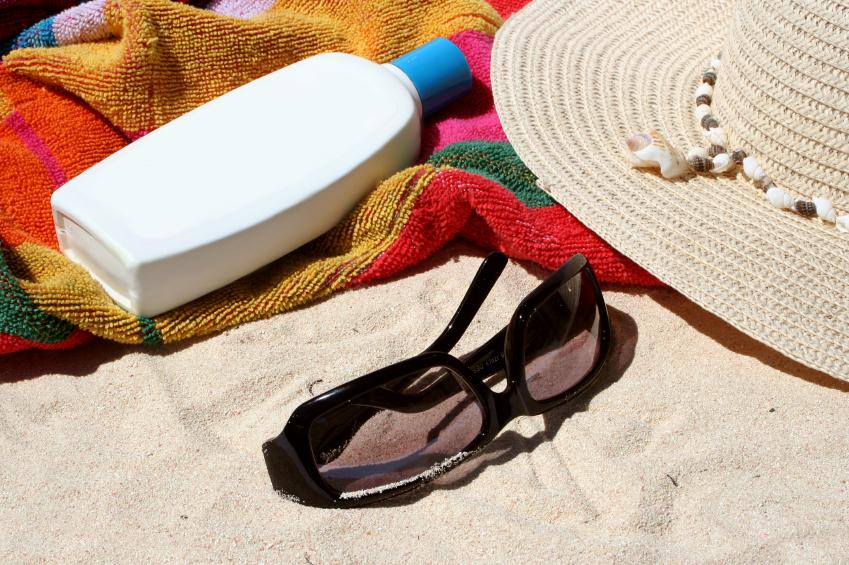 beach bag and beach items and sun block