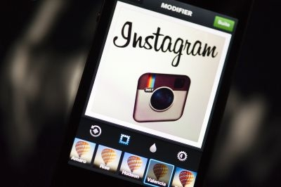 The former Instagram logo displayed on a smartphone.