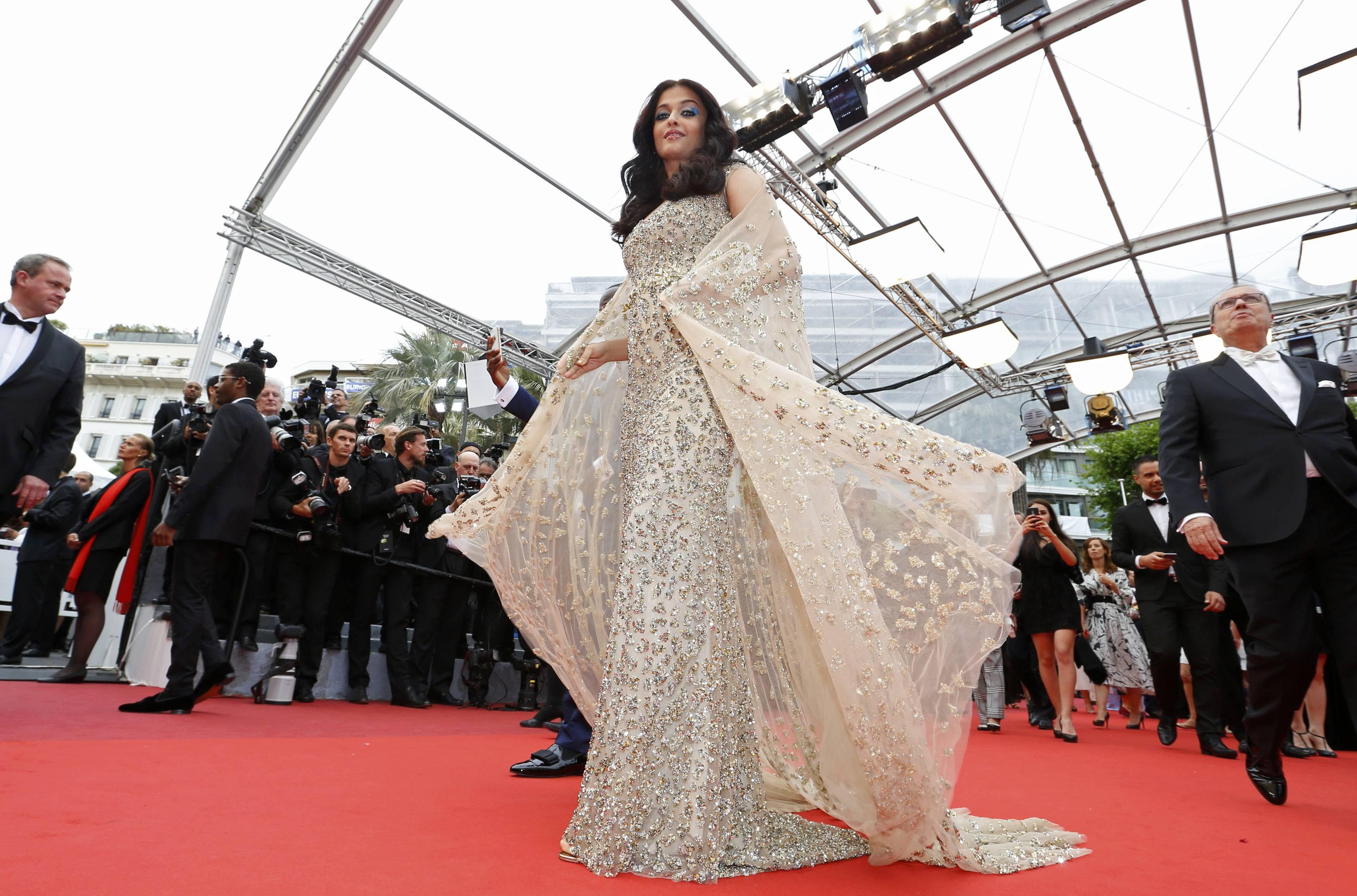 "Bollywood actress Aishwarya Rai poses on the red carpet as she arrives for the screening of the film ""Ma loute"" (Slack Bay) in competition at the 69th Cannes Film Festival in Cannes, France, May 13, 2016. REUTERS/Yves Herman"