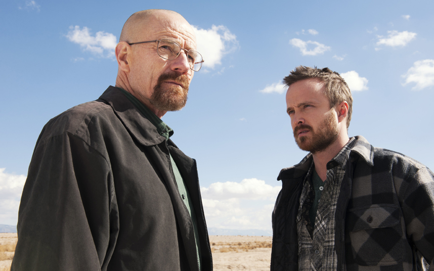 "This image released by AMC shows Bryan Cranston, left, and Aaron Paul in a scene from ""Breaking Bad."" Paul is nominated for best supporting actor in a drama series for his role as Jesse Pinkman. The Academy of Television Arts & Sciences' Emmy ceremony will be hosted by Neil Patrick Harris. It will air Sept. 22 on CBS. (AP Photo/AMC, Frank Ockenfels )"