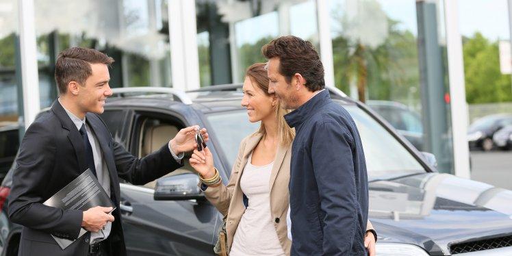 browsing-new-car-showroom-keys-salesman