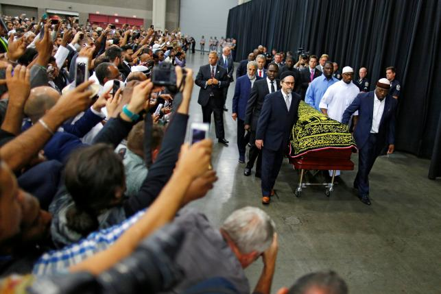 Worshipers and well-wishers take photographs as the casket with the body of the late boxing champion Muhammad Ali is brought for his jenazah, an Islamic funeral prayer, in Louisville, Kentucky, U.S. June 9, 2016. REUTERS/Carlos Barria