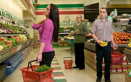 Men ogling woman in supermarket