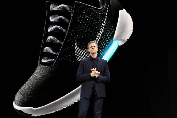 Nike president and CEO Mark Parker reveals their latest innovative sports products during an event in New York on March 16, 2016. Nike revealed a series of products highlighted by the groundbreaking ìadaptive lacingî platform, as well as a pioneering technology that separates mud from cleats and transformations in the celebrated innovations of Nike Air and Nike Flyknit. / AFP / Jewel SAMAD